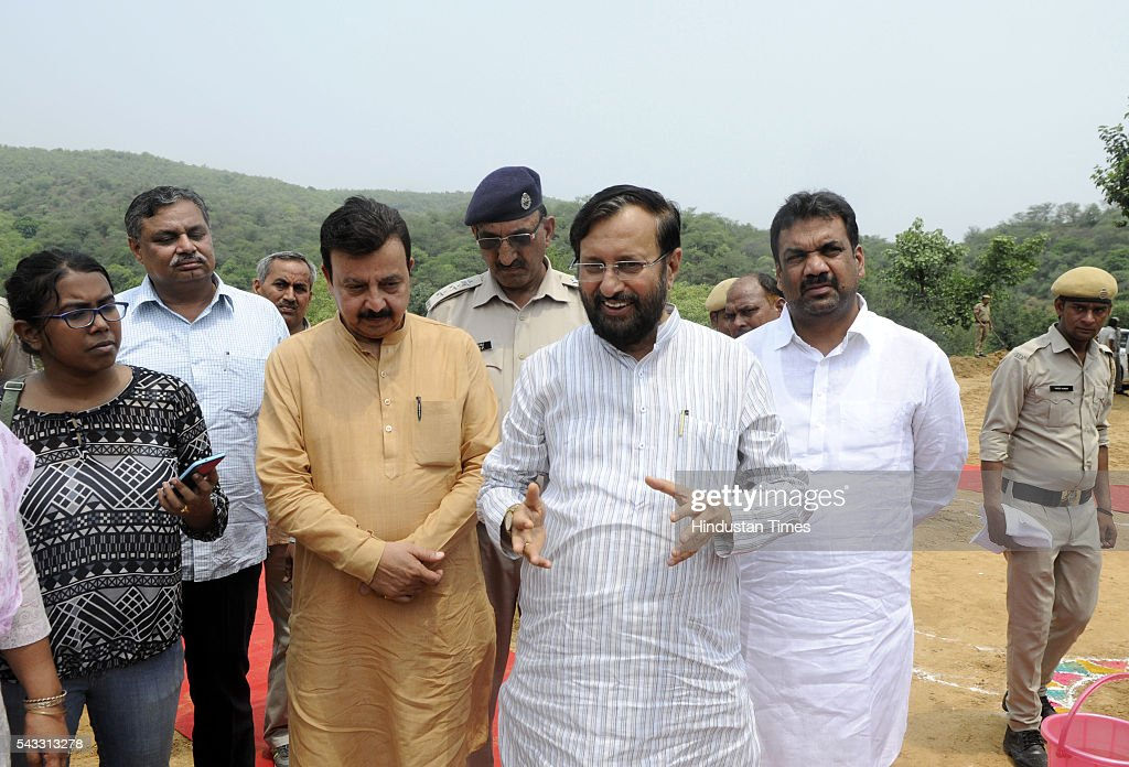The Union minister for environment, forest and climate Prakash Javadekar along with Rao Narbir Singh PWD Minister Haryana inspecting newly constructed rain water harvesting dam at Jhirka on June 27, 2016 in Gurgaon, India. Prakash Javadekar conducted an aerial survey of the forest cover in Gurgaon and Mewat districts of Haryana, with a view to understand the Aravallis range. The minister said that a new policy will be framed to protect ecologically sensitive Aravallis taking into accounts all the previous judgments related to the issue.