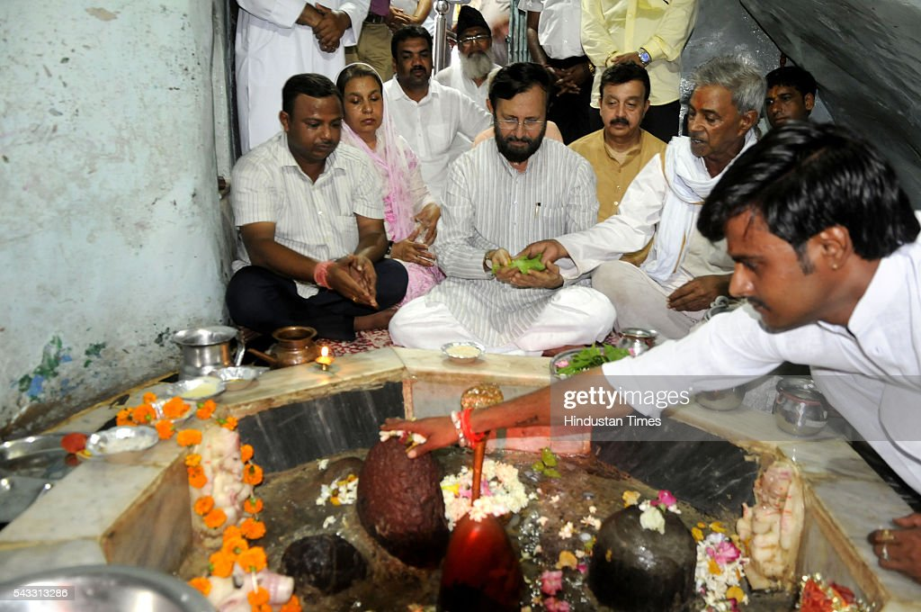 The Union minister for environment, forest and climate Prakash Javadekar along with Haryana PWD Minister Rao Narbir Singh at Jhirka temple on June 27, 2016 in Gurgaon, India. Prakash Javadekar conducted an aerial survey of the forest cover in Gurgaon and Mewat districts of Haryana, with a view to understand the Aravallis range. The minister said that a new policy will be framed to protect ecologically sensitive Aravallis taking into accounts all the previous judgments related to the issue.