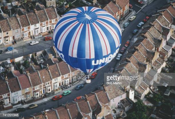 The Unipart hot air balloon makes a pass over the Ashton Court Estate during the Bristol International Balloon Fiesta on 15 August 1990 in Bristol...