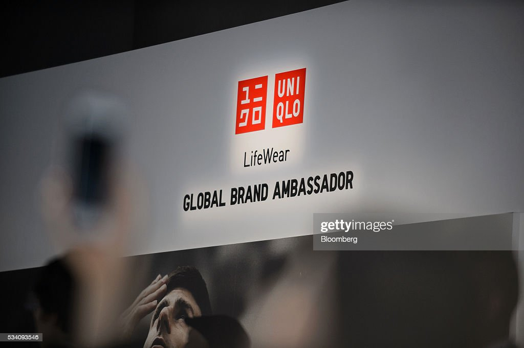 The Uniqlo logo is displayed during a preview of Fast Retailing Co.'s Uniqlo 2016 Fall-Winter lineup in Tokyo, Japan, on Wednesday, May 25, 2016. Analysts and investors will be watching as Uniqlo unveils the new season's LifeWear line in Tokyo to see whether Chairman Tadashi Yanai will come through with his pledge to offer the 'lowest possible prices.' Photographer: Akio Kon/Bloomberg via Getty Images