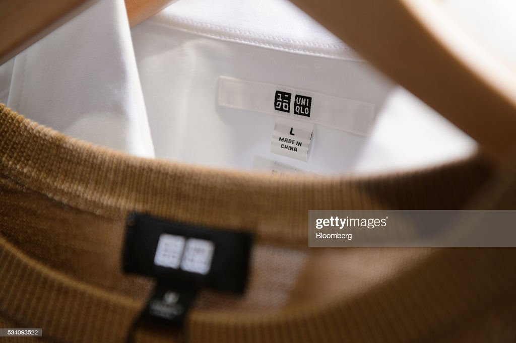 The Uniqlo logo is displayed on a clothing label during a preview of Fast Retailing Co.'s Uniqlo 2016 Fall-Winter lineup in Tokyo, Japan, on Wednesday, May 25, 2016. Analysts and investors will be watching as Uniqlo unveils the new season's LifeWear line in Tokyo to see whether Chairman Tadashi Yanai will come through with his pledge to offer the 'lowest possible prices.' Photographer: Akio Kon/Bloomberg via Getty Images