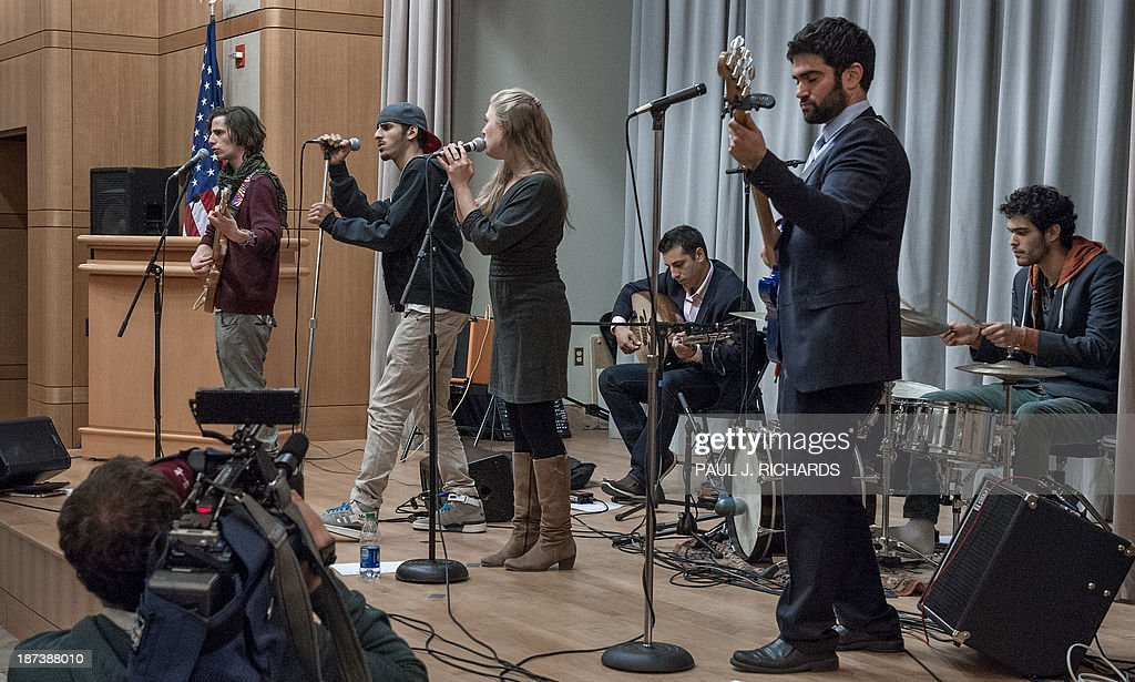The unique band 'Heartbeat' performs November 8, 2013 inside the US Department of State in Washington. The Jerusalem-based band unites Israeli and Palestinian youth musicians and are starting their second US tour to build understanding. AFP PHOTO/Paul J. Richards