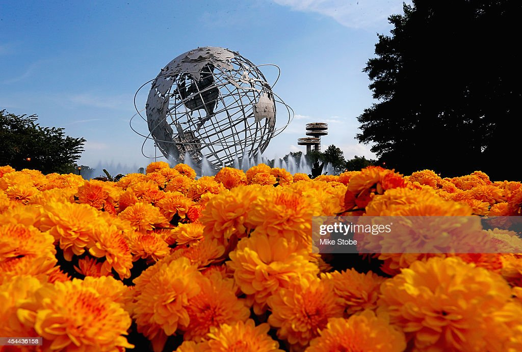 The Unisphere is seen beyond a flowerbed in Corona Park on Day Seven of the 2014 US Open at the USTA Billie Jean King National Tennis Center on...
