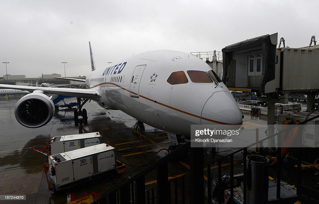 The United Airlines Boeing 787 Dreamliner sits a a gate for a tour at Los Angeles International Airport on November 30, 2012 in Los Angeles, California. In January the new jet is scheduled to begin flying daily non-stop between Los Angeles International airport and Japan's Narita International Airport and later to Shanghai staring in March. The new Boeing 787 Dreamliner will accommodate 219 travelers with 36 seat in United Business First, 70 seats in Economy Plus and 113 in Economy Class. The carbon-fiber composite material that makes up more than 50 percent of the 787 makes the plane jet and more fuel-efficient.
