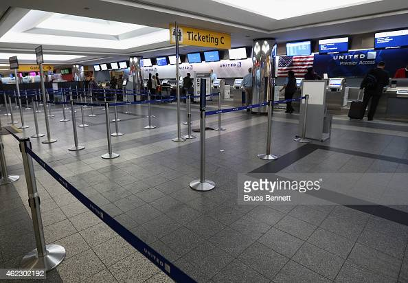 The United Airlines check in area shows the effects of numerous cancelled flights as a storm approaches the tristate area and Laguardia Airport on...