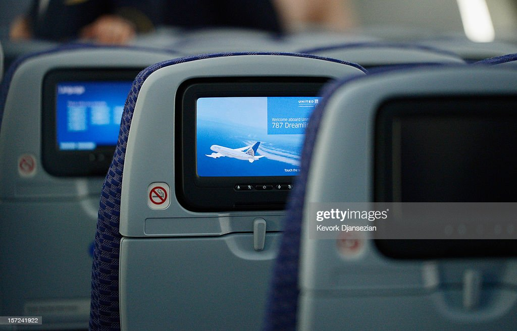 The United Airlines Economy Class with personal entertainment systems, with 13 languages available, is seen on the new Boeing 787 Dreamliner at Los Angeles International Airport on November 30, 2012 in Los Angeles, California. In January the new jet is scheduled to begin flying daily non-stop between Los Angeles International airport and Japan's Narita International Airport and later to Shanghai staring in March. The new Boeing 787 Dreamliner will accommodate 219 travelers with 36 seats in United Business First, 70 seats in Economy Plus and 113 in Economy Class. The carbon-fiber composite material that makes up more than 50 percent of the 787 makes the plane more fuel-efficient.