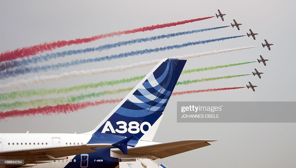 The United Arab 1st Aerobatic team perform in their MB339A jets perform next to an Airbus A380 jet at the Airshow China 2014 in Zhuhai south China's...