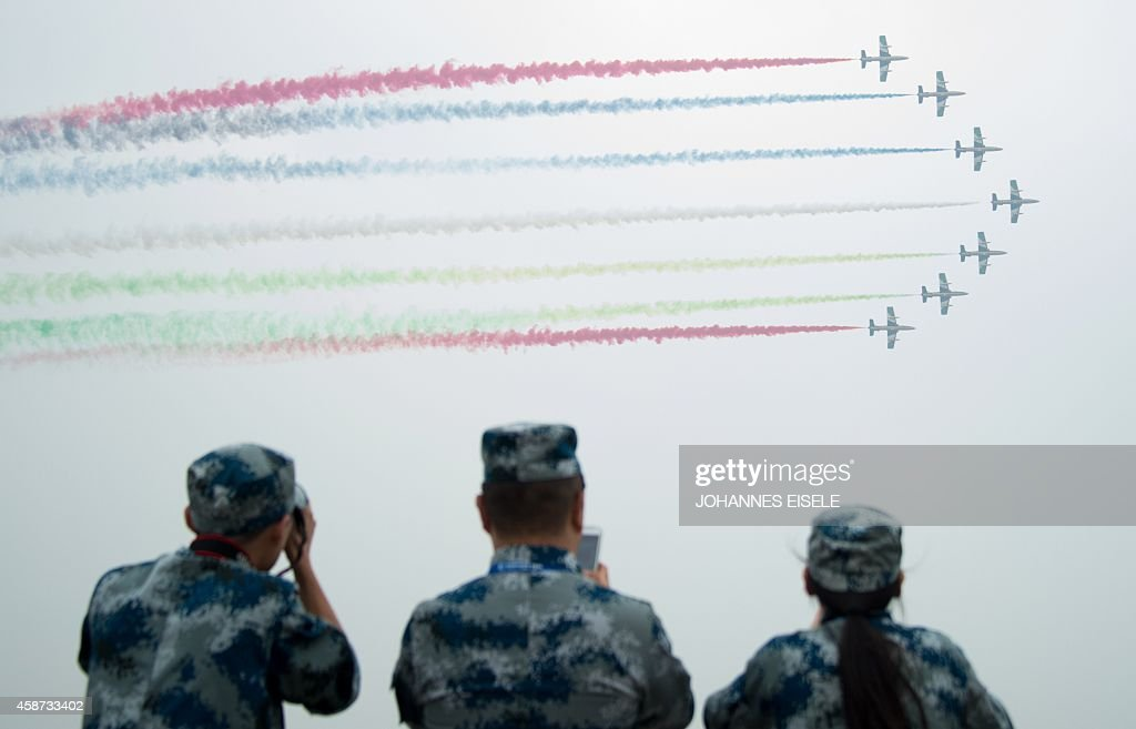 The united Arab 1st Aerobatic team performs in their MB339A jets during a test flight ahead of the Airshow China 2014 in Zhuhai South China's...