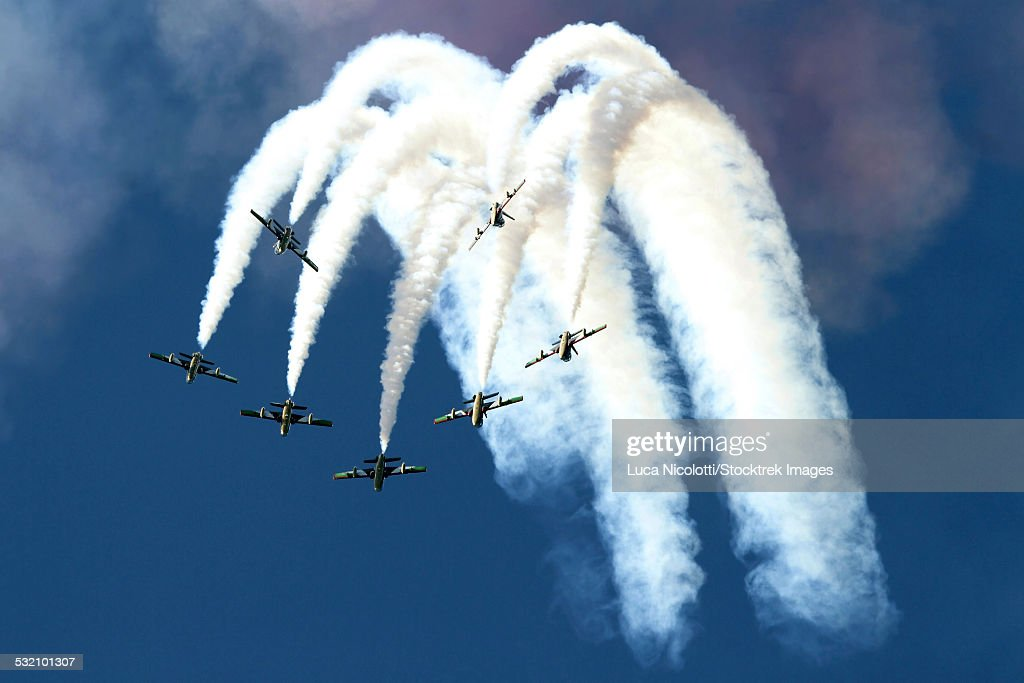 The United Arab Emirates Al Fursan aerobatic team perform demonstrations in their MB-339 aircraft at the AIR14 air show in Payerne, Switzerland.