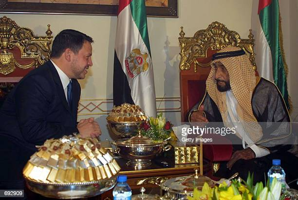 The United Arab Emirates leader Sheikh Zayed bin Sultan alNahyan meets with Jordans King Abdullah II January 7 2002 in Abu Dhabi Bahrain The...