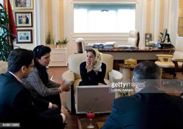 The United Arab Emirates' Minister of Economics Sheikha Lubna Khalid Al Qasimi listens to a proposal from Princess Sumaya bint El Hassan of Jordan in...