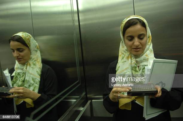 The United Arab Emirates' Minister of Economics Sheikha Lubna Khalid Al Qasimi rides the elevator in her office building in Abu Dhabi United Arab...
