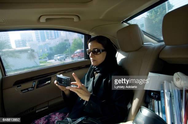 The United Arab Emirates' Minister of Economics Sheikha Lubna Khalid Al Qasimi types a text message on her mobile phone in Abu Dhabi United Arab...