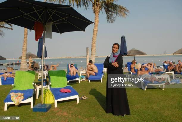 The United Arab Emirates' Minister of Economics Sheikha Lubna Khalid Al Qasimi stands among sunbathers in Abu Dhabi United Arab Emirates on Nov 13...