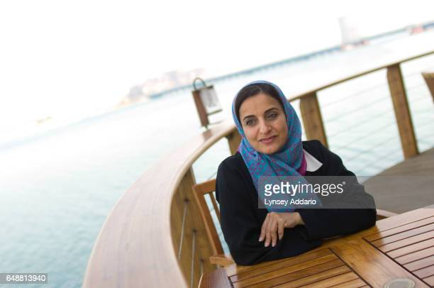 The United Arab Emirates' Minister of Economics Sheikha Lubna Khalid Al Qasimi sits on the waterfront of Abu Dhabi United Arab Emirates on Nov 13 2007