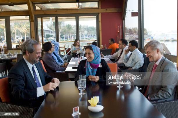 The United Arab Emirates' Minister of Economics Sheikha Lubna Khalid Al Qasimi meets with Juan Enriquez left of Excel Medical Ventures and Edward...