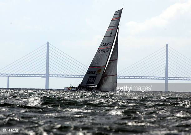 The United Internet Team Germany competes as the new Oeresund bridge is seen in the background during the Louis Vuitton Act 6 on August 26 2005 in...