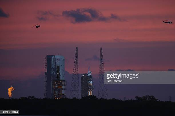 The United Launch Alliance Delta 4 rocket carrying NASA's first Orion deep space exploration craft is seen on its launch pad before the mornings...