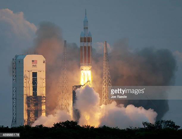 The United Launch Alliance Delta 4 rocket carrying NASA's first Orion deep space exploration craft takes off from its launchpad on December 5 2014 in...