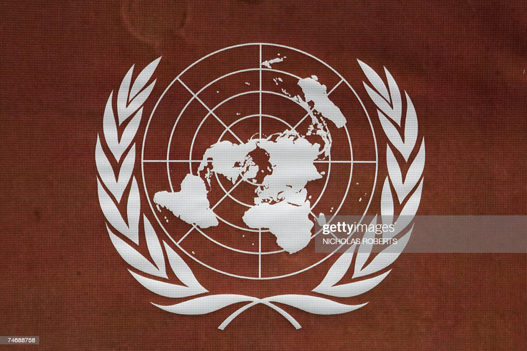 The United Nations emblem is pictured on a window at UN headquarters in New York 15 June 2007 AFP PHOTO/Nicholas ROBERTS