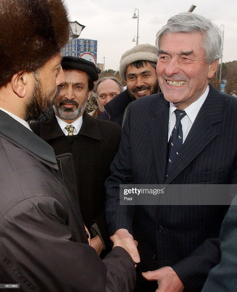 The United Nations High Commisioner for Refugees Ruud Lubbers (R) shakes hands with Afghanistan's Governor of the Ballkh Province Mohammad Ashaq Rahguzer following their meeting at the Ministry of Foreign Affairs February 28, 2003 in Mazar-e-Sharif, Afghanistan. Lubbers and numerous factional leaders from northern Afghanistan, unanimously agreed to improve the infrastructure of the region so displaced people can return home.