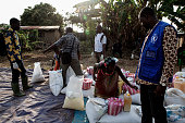 The United Nations World Food Program distributes food to the1150 families of Womey Guinea on January 24 2015 After the killing of eight people who...