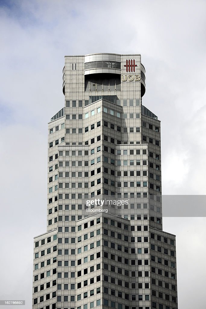 The United Overseas Bank Ltd. (UOB) logo is displayed atop UOB Plaza One in Singapore, on Wednesday, Feb. 27, 2013. UOB is scheduled to announce full year results today. Photographer: Munshi Ahmed/Bloomberg via Getty Images