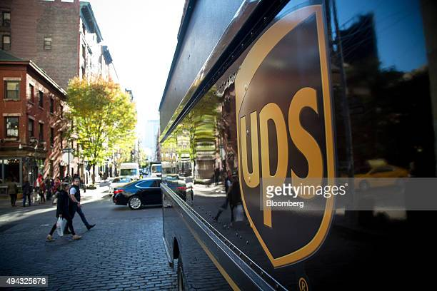 The United Parcel Service Inc logo is displayed on a truck parked in New York US on Friday Oct 23 2015 UPS is scheduled to release thirdquarter...