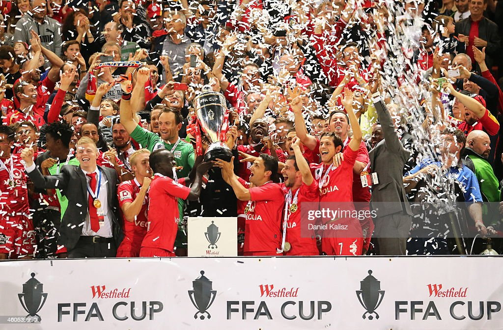 The United players celebrate after the FFA Cup Final match between Adelaide United and Perth Glory at Coopers Stadium on December 16, 2014 in Adelaide, Australia.