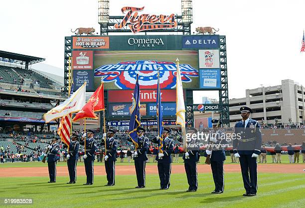 The United States Air Force Honor Guard stand on the field and present colors during the National Anthem prior to the Opening Day game between the...