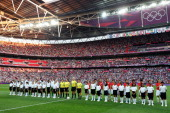 The United States and Japan stand during the national anthem before the Women's Football gold medal match on Day 13 of the London 2012 Olympic Games...