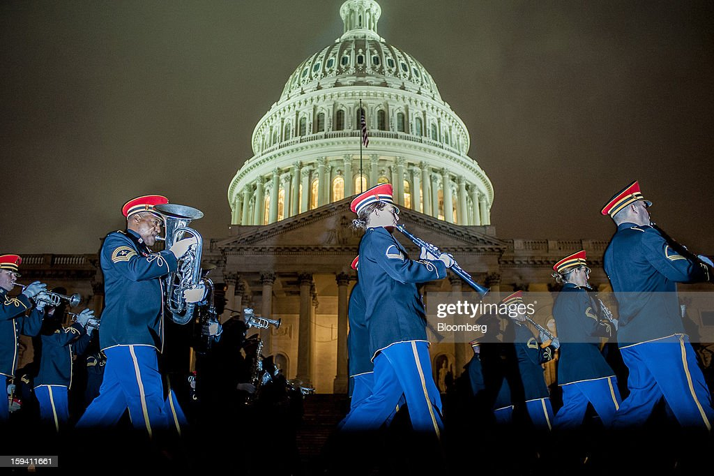 The United States Army Band rehearses for the 2013 presidential inaugural ceremonies in front of the East Front of the U.S. Capitol in Washington, D.C., U.S., on Sunday, Jan. 13, 2013. U.S. President Barack Obama will take the oath of office for another four-year term on Monday, Jan. 21, 2013. Photographer: Pete Marovich/Bloomberg via Getty Images