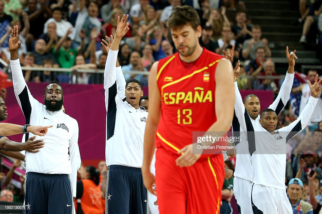 The United States bench celebrate as <a gi-track='captionPersonalityLinkClicked' href=/galleries/search?phrase=Marc+Gasol&family=editorial&specificpeople=661205 ng-click='$event.stopPropagation()'>Marc Gasol</a> #13 of Spain shows his emotion in the Men's Basketball gold medal game between the United States and Spain on Day 16 of the London 2012 Olympics Games at North Greenwich Arena on August 12, 2012 in London, England.