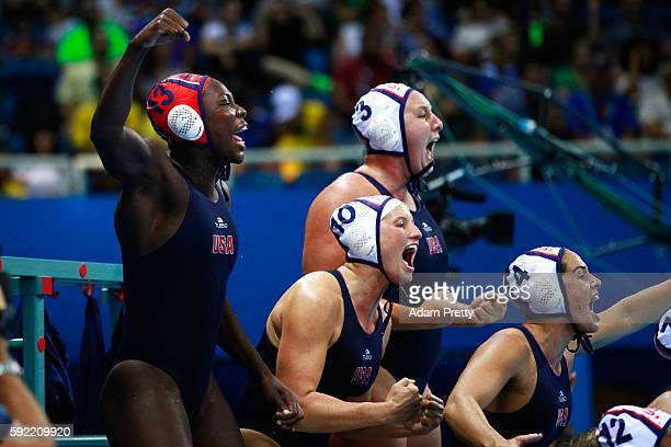 The United States bench cheer in the Women's Water Polo Gold Medal Classification match between the United States and Italy on Day 14 of the Rio 2016...