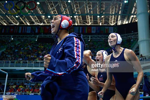 The United States bench react in the Women's Water Polo Gold Medal Classification match between the United States and Italy on Day 14 of the Rio 2016...