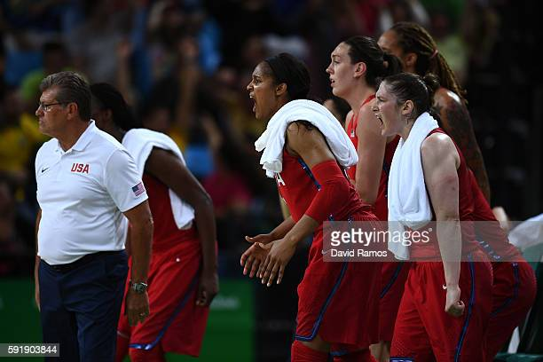 The United States bench reacts during a Women's Semifinal Basketball game between the United States and France at the Carioca Arena on Day 13 of the...
