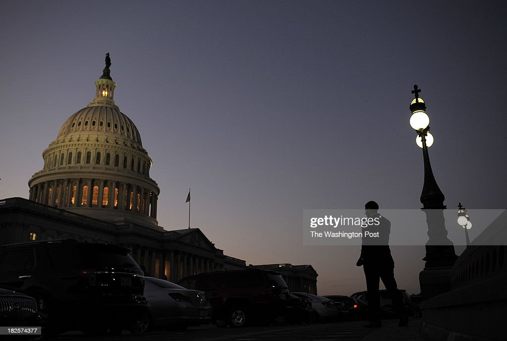 The United States Capitol is illuminated at dusk as a possible government shutdown nears on Monday September 30, 2013 in Washington, DC.