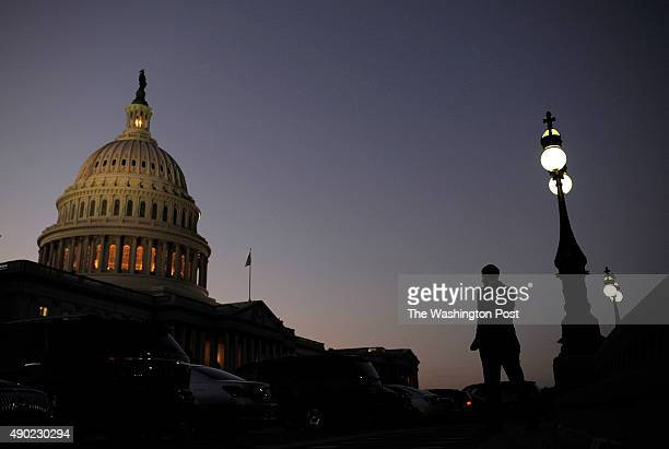 The United States Capitol is illuminated at dusk as a possible government shutdown nears on Monday September 30 2013 in Washington DC