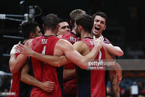 The United States celebrate a point over Italy during the Men's Volleyball Semifinal match on Day 14 of the Rio 2016 Olympic Games at the...