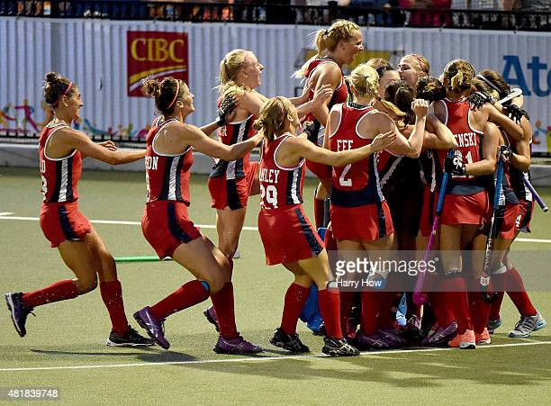 The United States celebrate a victory over Argentina in the women's field hockey gold medal game during the 2015 Pan Am Games at Pan Am Fields on...