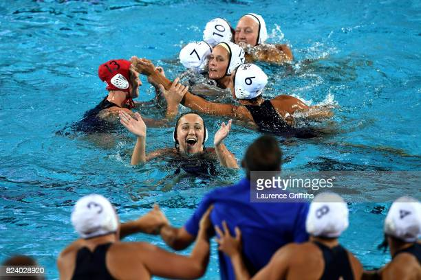The United States celebrates following their team's 136 victory during the Women's Water Polo gold medal match between the United States and Spain on...