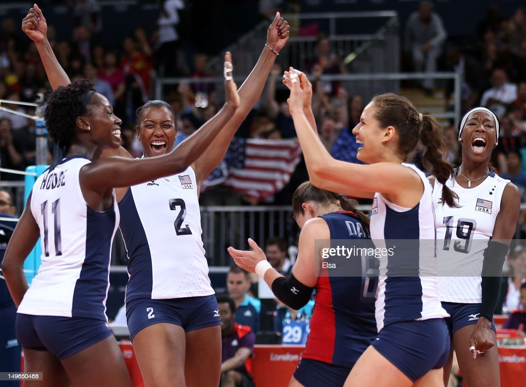 The United States celebrates their match win over China during Women's Volleyball on Day 5 of the London 2012 Olympic Games at Earls Court on August 1, 2012 in London, England.