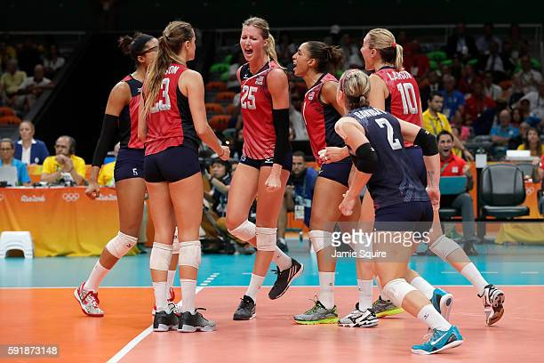 The United States celebrates while taking on Serbia while taking on Serbia in the Women's Volleyball Semifinal match at the Maracanazinho on Day 13...