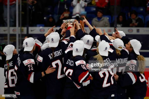 The United States celebrates with the championship trophy after a 32 overtime win against Canada at the 2017 IIHF Woman's World Championships at USA...