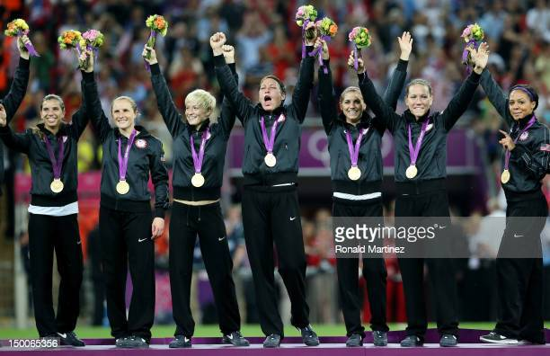 The United States celebrates with the the gold medal after defeating Japan by a score of 21 to win the Women's Football gold medal match on Day 13 of...