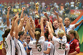 The United States celebrates with the World Cup Trophy after their 52 win over Japan in the FIFA Women's World Cup Canada 2015 Final at BC Place...