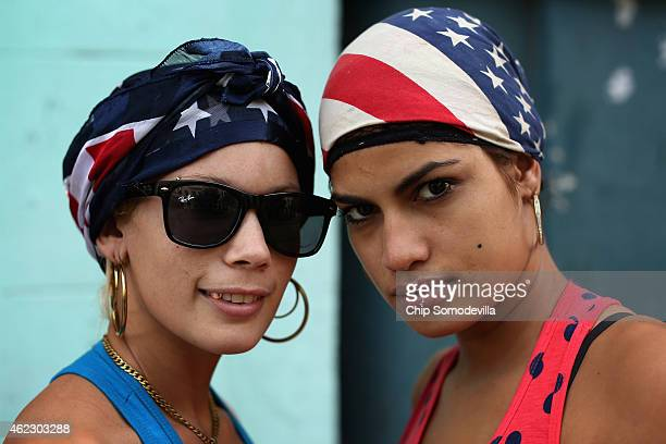 The United States flag is appearing in small ways in the clothing worn by Cubans liek the scarves worn by Gydis Ricardo Vargas and Yaime Machado...