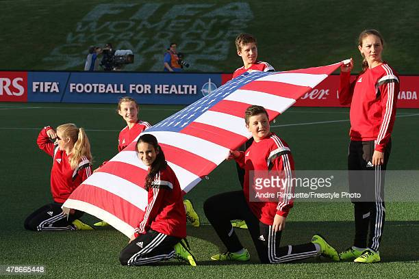 The United States flag is held during national anthems prior to the match against China in the FIFA Women's World Cup 2015 Quarter Final match at...
