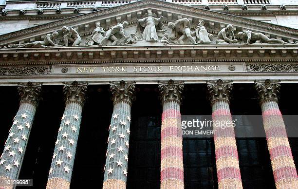 The United States flag is illuminated on the front of the New York Stock Exchange 20 December 2006 in New York Shareholders in the New York Stock...