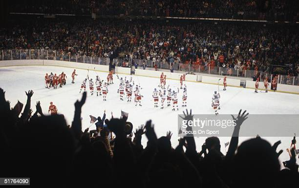 The United States hockey team celebrates on the ice after defeating the Soviet Union team on February 22 1980 during the 1980 Winter Olympics in Lake...